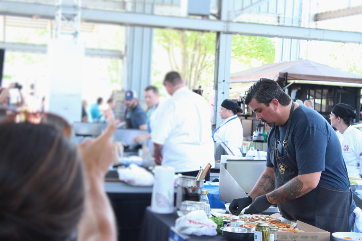 Chef Eric Fulkerson competing in the Five Star Food Fight at the Chattanooga Market.