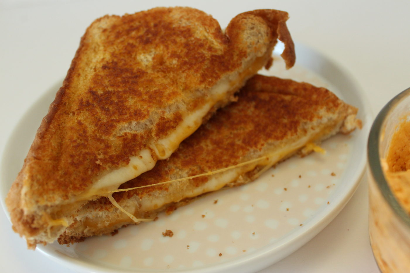 Adding sriracha butter to a comforting grilled cheese sandwich gives it the richest flavor.