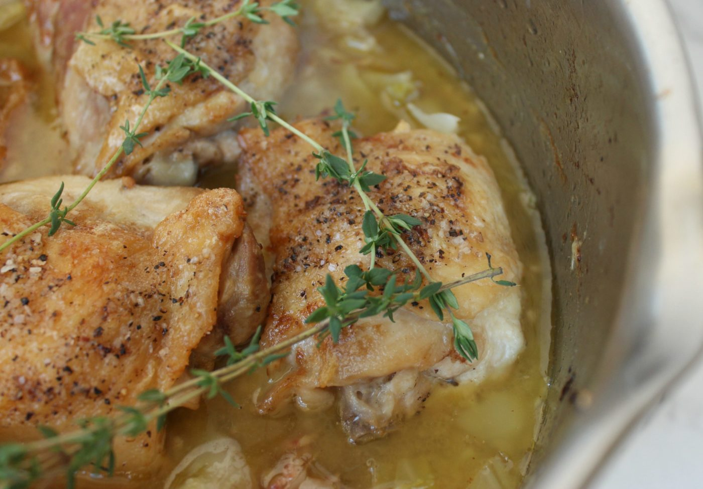 Braised chicken thighs and cabbage.