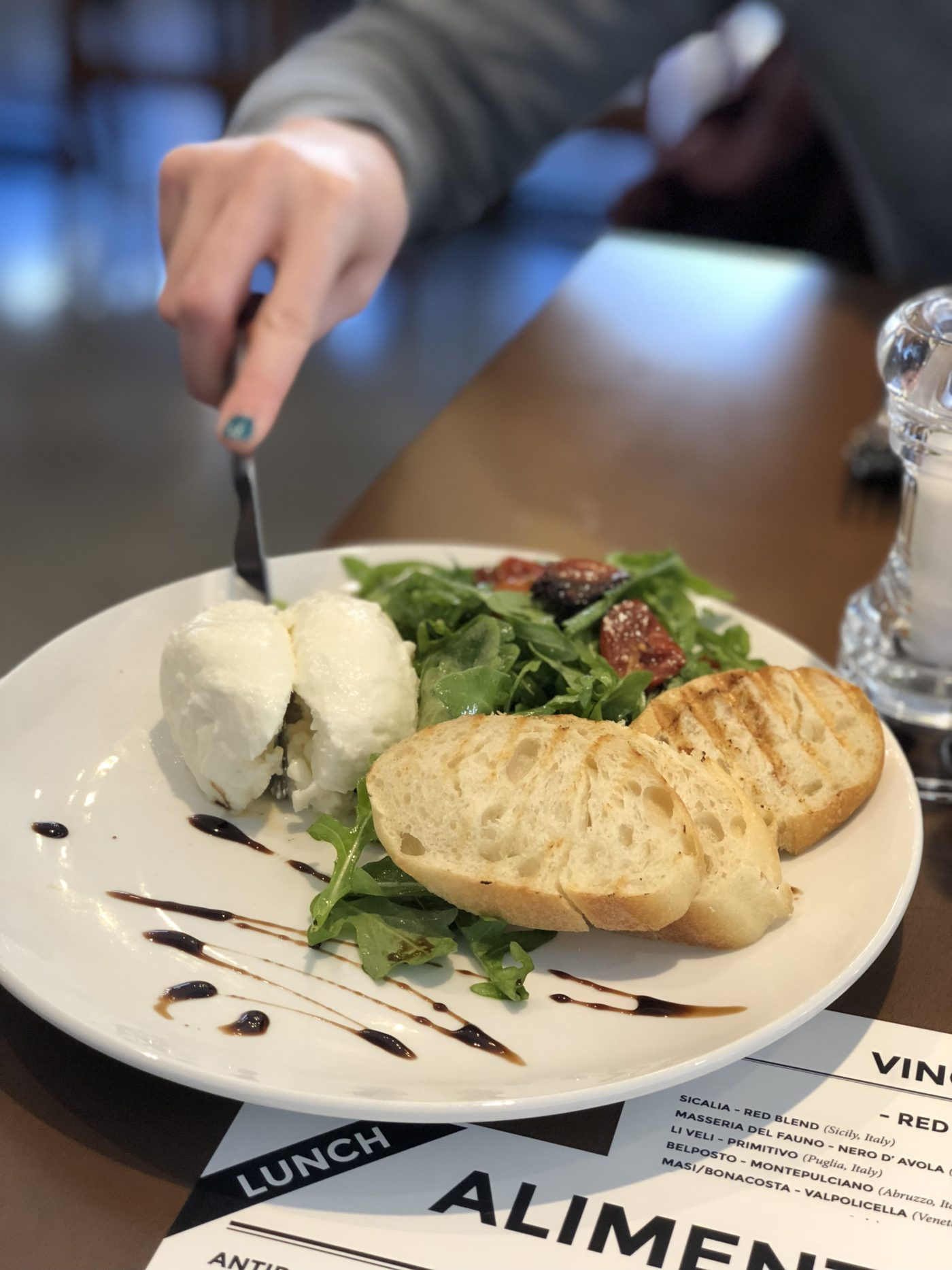 knife cutting into fresh burrata