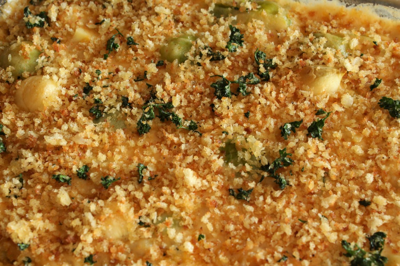 close up of baked brussels sprouts with panko crumbs