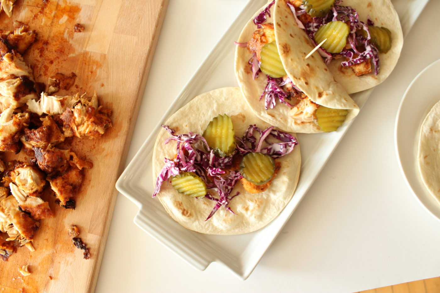 white plate of chicken tacos